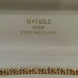 18 k over sterling silver tennis bracelet